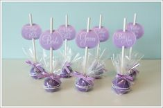 Purple cake Pops for place cards. Like how the cellophane is wrapped around just the cake ball