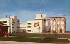 """Exterior view of the Schlitz Brewery in Van Nuys, California which opened in 1954. As the underside of this postcard reads, """"The new West Coast Home of the Schlitze Brewery has contributed greatly to the rapid expansion of the San Fernando Valley."""" San Fernando Valley History Digital Library."""