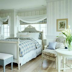 Like the idea of the sheer swag curtains over the cornice board - which matches the bedspread - keeps the eye moving