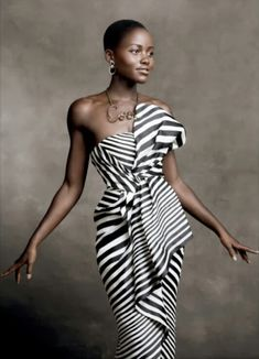 Lupita Nyong'o. Ever since 12 Years a Slave, she's seriously been my favorite. So stunning, so talented, amazing skin and bold and beautiful with her TWA! lupita nyong'o, the dress, style icons, black white, lupita nyong'o, lupita nyongo, african fashion dresses, couture fashion, black stripe