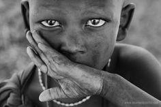 Africa | 'Speak no evil'.  A Masai boy photographed in Tanzania  | © Stephan Brauchli