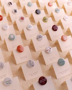 This couple designed buttons specifically for each guest and attached them to seating cards. After everyone found their assigned tables, they could wear the buttons, which were great conversation starters