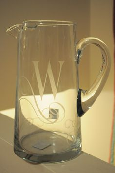 "Great neighbor gift. Personally monogram a glass pitcher, add a packet of drink mix & a note that says: We ""pitcher"" you ""stirring"" up some holiday cheer!!!"
