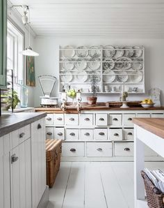 I want the cabinet in the back... All those drawers that would make an awesome craft storage place !