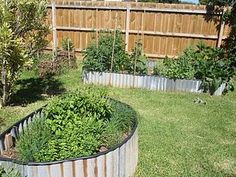 raised bed idea - scrap metal (could be corrugated or not) with a hose slit and stuck on top