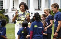 Mrs Obama wearing Peter Som 'Splash Floral' silk top.