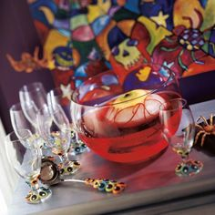Make this eyeball ice ring for your punch bowl. You'll need: Round-bottom bowl or rounded lettuce-crisper lid, Flat-bottom bowl, Kiwi fruit, Black olive, Chunk-style pineapple, Red lace candy, and Dark-red punch or soft drink.  #Halloween