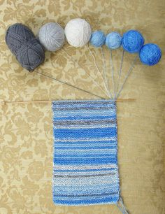 The Sky Scarf: one row a day for a year, matched to the color of the sky that day. Such a cool idea!