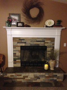 Air stone fireplace with slate. Mixed autumn mountain and spring creek all at Lowes.