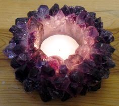 for the past year i've been really wanting a geode candle holder. i also love the rock crystal ones...when they are lit they are gorgeous and a great addition to any room.