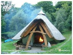 This is the Celtic Roundhouse at the Cae Mabon Retreat Centre in Wales. It is set in natural woodland by a rushing river near a deep lake at the foot of high mountains. The roundhouse is one of several beautiful, natural, earthy structures used for people to meet and tell stories. You can see the collection of buildings at Cae Mabon on the Natural
