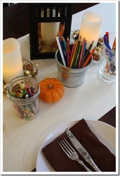 Keep kids entertained: spread paper on the table and provide crayons and colored pencils for drawing.