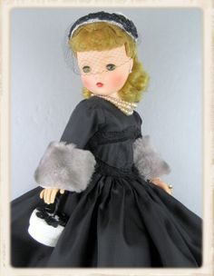 Simple elegance! A beautiful blonde vintage Cissy in black taffeta.