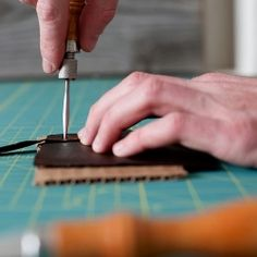 Interesting leather work techniques. How to hand stitch, cut, mark holes for stitching etc. Includes mistakes. ...A full how-to tutorial on making a simple leather strap wallet. From cutting to staining, and hand stitching.