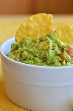 Guacamole: 3 avocados, peeled and pitted + juice of 1 lime + 1 teaspoon salt + 2 Roma tomatoes, diced + 1/4 onion, diced + 1 teaspoon minced garlic + 3 tablespoons chopped cilantro + ground cayenne pepper, to taste (about a pinch)