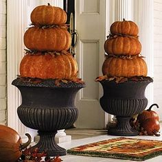 autumn+front+door | Fall front door decor with pumpkins in planters | For the Home