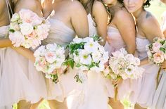 Blush and bashful bouquets and bridal party.