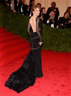 """Renee Zellweger attends the Costume Institute's gala for the exhibit """"Schiaparelli and Prada: Impossible Conversations"""" at New York's Metropolitan Museum of Art on May 7, 2012."""