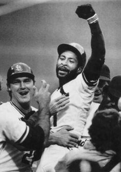 October 14, 1985 -- St. Louis Cardinal Ozzie Smith reacts to the crowd and his teammates after hitting a game-winning home run in the ninth inning to defeat the Los Angeles Dodgers 3-2. Tommy Herr pats his chest.