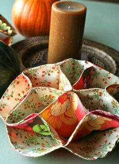 Sew this pretty dinner rollbasket for Thanksgiving andset your table with this free sewing tutorial by Virginia Lindsay! These little fabric baskets would also make nice house warming giftsalon...