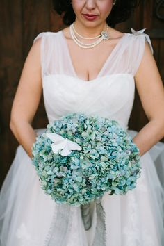 blue hydrangea bouquet, photo by Joe+Kathrina http://ruffledblog.com/whimsical-san-juan-capistrano-wedding #flowers #weddingbouquet #bluehydrangea