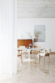 Home Tour: Ladylike Scandinavian Simplicity// sheepskin, Saarinen table