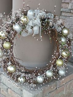 Grapevine winter wreath - (1) grapevine wreath (2) ornaments (3) floral or berry sprays, etc. (4) ribbon for bow (5) glue gun