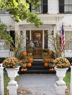 Don't confine pumpkins to the ground: If your porch has a stable overhang, like the one pictured here, use a ladder to elevate your display by placing a few mini pumpkins overhead.