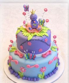 I like some aspects of this for O's frog birthday cake to keep it girly.