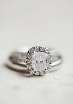 Take a peek at Style Me Pretty's gallery of engagement and wedding rings (here): http://www.stylemepretty.com/gallery/tag/rings/   Paperlily Photography