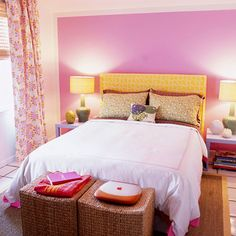 Draw the Eye  Painting one wall an eye-catching color is a fast and effective way to create a focal point. Here, the sweet fuchsia color could have turned sickly if applied to the whole room. By limiting the violet tint to one wall and contrasting it with the complementary yellow headboard, the bed takes center stage.