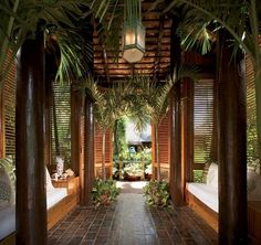 """""""The Balinese style allows the trade winds to circulate and gives an indoor-outdoor atmosphere to the rooms,"""" says Fernandez.The entranceway to Casa Grande Framina, which has flooring made of railroad ties."""