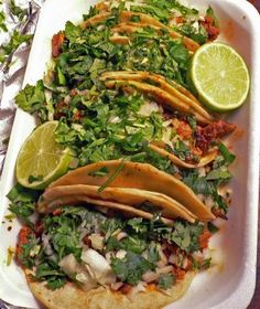 Tacos al pastor. These guys are filled with really yummy pork, cilantro, onion and pineapple!.