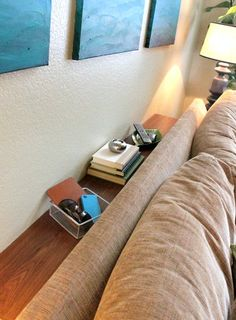 turn an old bookcase on its side and place behind couch for extra table space behind sofa