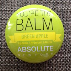 Absolute New York lip balm in green apple - lightly swatches once with clean fingertip