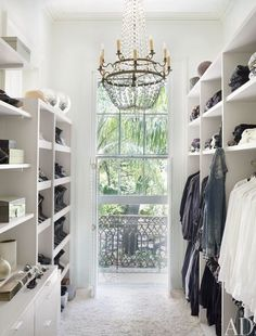 Great juxtaposition between minimalist closet space and dramatic light fixture