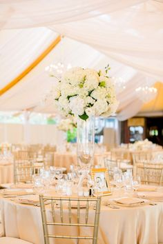 elegant white centerpiece photographed by Mikhail Glabets Photography | via junebugweddings.com
