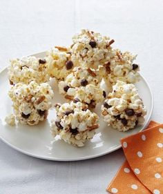 Give popcorn balls a sweet-and-salty twist with chocolate-covered peanuts and pretzels.