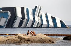 Tourists sunbathing next to the Costa Concordia.  Twenty-eight people were killed when the cruise ship capsized off the coast of Italy.  Max Rossi/Reuters 2012