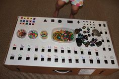 Drop box- Easy DIY play based learning, dropbox, cardboard boxes, mom blogs, mom llc, drop box, painted letters, toddler, kid