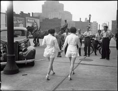 Two women show uncovered legs in public for the first time in Toronto. 1937.