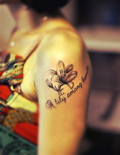 lily tattoo on the arm