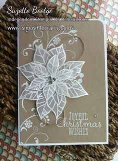 Stampin' Up! ... Joyful Christmas Card from Simosihle Crafts blog ... kraft main panel with pure white .. luv the layered poinsettia flower embossed in white on translucent vellum ... flourishes and sentiment stamped in white ... lovely ...