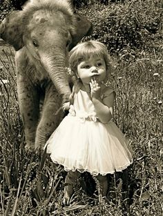 A wee girl with a wee pachyderm. <3