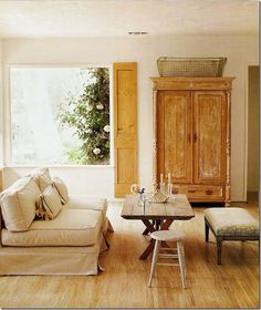 living space, lots of light, lovely wood tones, slipcovered furniture, neutral colors