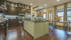 The kitchen often serves as the hub of the home. Find your dream kitchen with stunning details such as upper display cabinets, at Bridges of Las Colinas in #Irving.