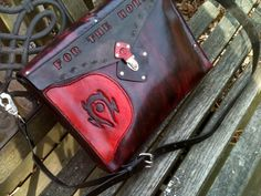 World of Warcraft Horde inspired Laptop bag by WorldofLeathercraft (they make an Alliance one too!)