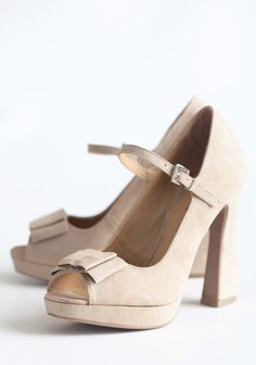 """Vienna Waits Open Toe Heels 48.99 at shopruche.com. A structural bow adorns the toe of these luxuriously soft beige heels polished with playful open toes and an adjustable ankle strap., , All man made materials, Slightly padded footbed, 4.75"""" heel"""