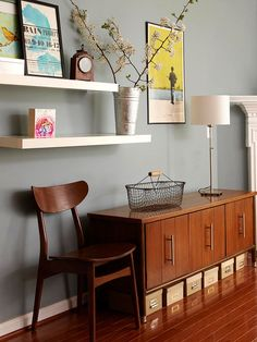 Don't forget to use the space beneath a console for beautiful storage containers {that all look the same!}, for pretty, practical, additional storage. #interiors #organizing #storagetips