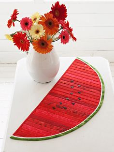 Quilt together the strips of this delicious red watermelon table runner. You'll finish in a flash.